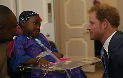 Prince Harry (right) greets Inspirational Child Award Winner Myzat Mugombo as he attends the WellChild Awards in London. The awards recognise the courage of seriously ill children, their families and carers.