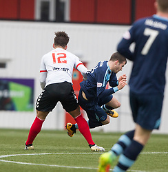 Clyde's Ryan Finnie injured in this tackle and gets stretchered off. Clyde 2 v 2 Forfar Athletic, Scottish League Two game played 4/3/2017 at Clyde's home ground, Broadwood Stadium, Cumbernauld.