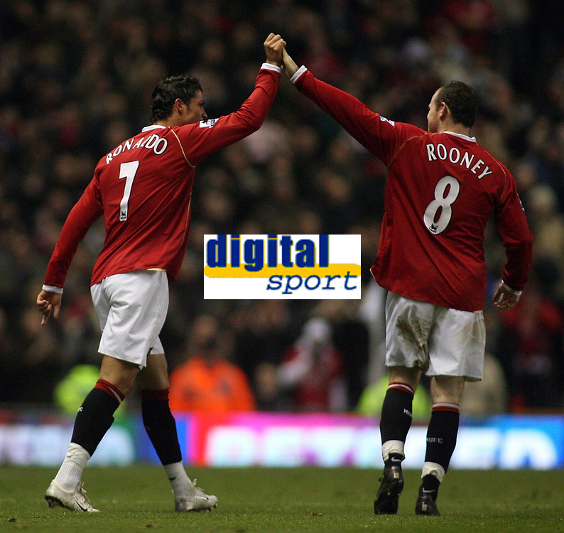 Photo: Paul Thomas.<br /> Manchester United v Wigan Athletic. The Barclays Premiership. 26/12/2006.<br /> <br /> Cristiano Ronaldo celebrates (L) his 1st goal for Man Utd with Wayne Rooney.