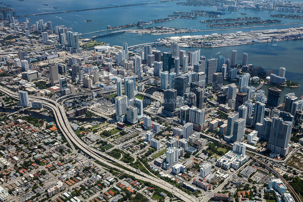 High angle aerial view looking down on downtown Miami from South to North with Brickell in the foreground.