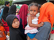 """Sept 29, 2009 - YARANG, THAILAND: A Muslim family walks through a street fair in Yarang, Pattani province, Thailand, Sept 29. Thailand's three southern most provinces; Yala, Pattani and Narathiwat are often called """"restive"""" and a decades long Muslim insurgency has gained traction recently. Nearly 4,000 people have been killed since 2004. The three southern provinces are under emergency control and there are more than 60,000 Thai military, police and paramilitary militia forces trying to keep the peace battling insurgents who favor car bombs and assassination.   Photo by Jack Kurtz / ZUMA  Press"""