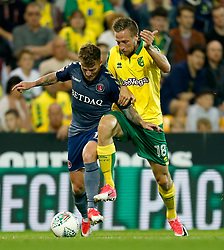 and Norwich City's Marco Stiepermann battle for the ball
