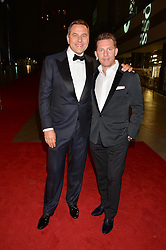 Left to right, DAVID WALLIAMS and NICK CANDY at the GQ Men of The Year Awards 2016 in association with Hugo Boss held at Tate Modern, London on 6th September 2016.