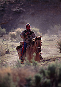 Shepherd on horseback along Atchees Wash south of the White River, Utah.