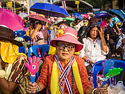 14 DECEMBER 2013 - BANGKOK, THAILAND:  People at an anti-government rally at Democracy Monument in Bangkok. The Thai anti-government movement, called the People's Democratic Reform Committee (PRDC) sponsored a forum Saturday to establish guidelines for political reform in Thailand. The opposition leader, Suther Thaugsuban, said his movement will not participate in a similar forum, sponsored by the government scheduled for Sunday. Thailand's political impasse continues with the opposition calling for the caretaker government of Prime Minister Yingluck Shinawatra to step down. Yingluck has, so far, refused to step down from her caretaker roll. Crowds at the anti-government rallies have shrunk substantially since the collapse of the government earlier in the week.       PHOTO BY JACK KURTZ