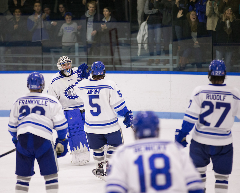 Emerson Verrier is congratulated by Dan Dupont after earning a 43 save shutout in a NCAA Division III hockey game between Colby College and Bowdoin College on December 4, 2015 at Alfond Rink on the campus of Colby College in Waterville, ME.  (Dustin Satloff)