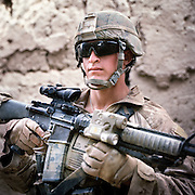 """Location:<br /> Patrol Base Fires, Sangin District, Helmand Province, Afghanistan<br /> <br /> Unit:<br /> 3rd Squad, 1st Platoon, Bravo Company, 1st Battalion, 5th Marines<br /> <br /> Name and Rank:<br /> Lance Corporal John Richard """"Bo"""" Bohlinger<br /> <br /> Age: 20<br /> <br /> Hometown: Cheyenne, Wyoming.<br /> <br /> Interview selections:<br /> <br /> Describe Sangin:<br /> <br /> """"It's like a firefight in a minefield.""""<br /> <br /> How does Sangin compare with your expectations?<br /> <br /> """"When we were first coming I was honestly expecting you couldn't move without hitting an IED and there were Taliban everywhere, and everyone was getting shot and blown up . . . that was my expectation . . . and it has not let me down.""""<br /> <br /> """"I don't think I had respect for the IEDs that I do now after seeing a few friends get hit. Knowing that you can step right next to one or sit with one right between your legs and never know it's there until someone steps on it and dies.""""<br /> <br /> What do you think the Taliban are fighting for?<br /> <br /> """"I think in their minds they think they're doing the right thing . . . it's just different ideals. I think they're thinking that they're winning the war and they're showing that America can't run the world.""""<br /> <br /> What's the hardest part of your job?<br /> <br /> """"I'm an RO, radio operator. The hardest part of my job has to be calling up casualties. I hate calling up casualties 'cause it's my friends and my brothers that're fucked up . . . yeah, that's the hardest part.""""<br /> <br /> Talk about one of your friends who was killed.<br /> <br /> """"My closest friend of the whole thing was Lance Corporal McDaniels . . . We had this joke going that if we took contact , I was gonna get up with him on point and he was gonna sweep right towards the fire and we were both gonna take extremity wounds and go home to our wives. You know, be in the hospital together and shit so we wouldn't be alone . . . that's the last thing I """