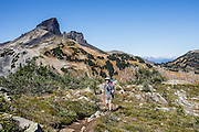 The volcanic pinnacle of Black Tusk (2319 m or 7608 ft), seen from the base of Panorama Ridge Trail. The Black Tusk is a remnant of an extinct andesitic stratovolcano which formed 1.3-1.1 million years ago: after long glacial erosion, renewed volcanism 170,000 years ago made the lava flow and dome forming the tooth-shaped summit. The top of Panorama Ridge is 17 miles round trip with 5100 feet gain from Rubble Creek parking lot (or 6 miles/10k RT with 2066 ft/630m gain from either Taylor Meadows or Garibaldi Lake Backcountry Campground). A hiking loop to Garibaldi Lake via Taylor Meadows Campground is 11 miles (18k) round trip, with 3010 ft (850m) gain. Garibaldi Provincial Park is east of the Sea to Sky Highway (Route 99) between Squamish and Whistler in the Coast Range, British Columbia, Canada.