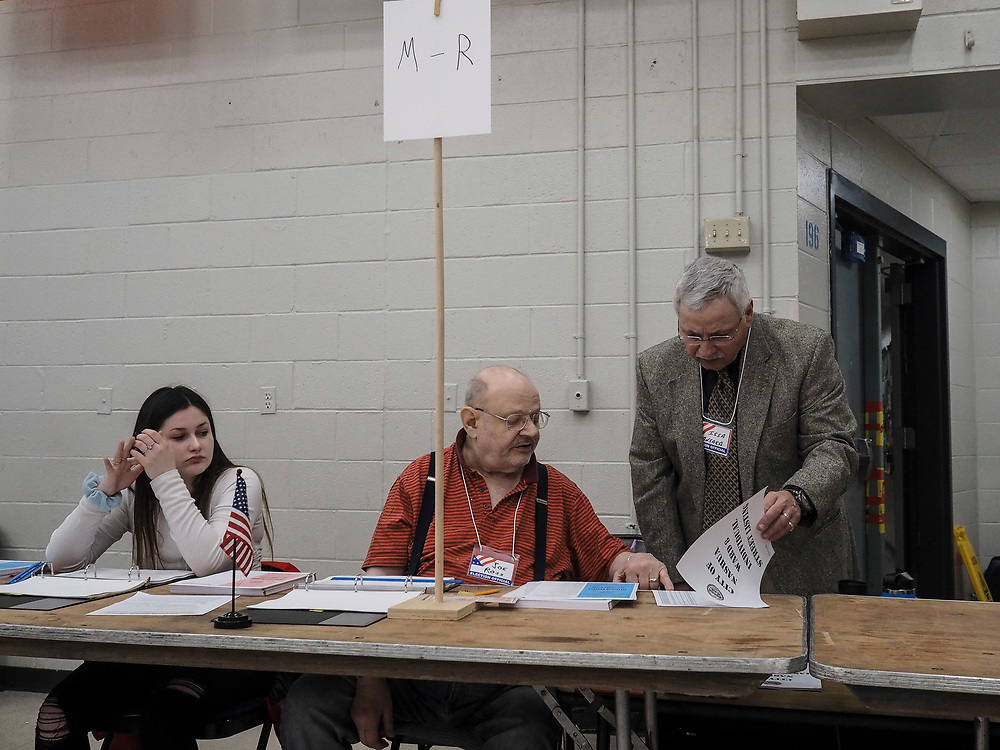 Voting officials review the registered voter list at Nashua, New Hampshire's Ward 8 polling site.