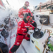 Leg 8 from Itajai to Newport, day 11 on board MAPFRE, Pablo Arrarte fixing the main's winch, Guillermo Altadill helping him. 02 May, 2018.