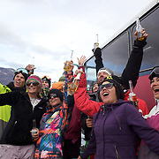Athletes enjoy a Corona beer after competition at the World Heli Challenge Extreme Day at Mount Albert on Minaret Station, Wanaka, New Zealand. 1st August 2011