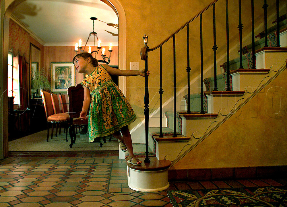 Newscasters Elliott Rodriguez and Maria Elena Salinas and their 1936 home in Coral Gables designed by Phineas Paest. Daughter, Julia Rodriguez, 5, says she swings on the staircase at home when she cannot use the swing hanging from a tree outside.