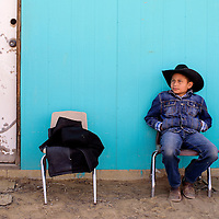 Lethan Burbank sits aside to watch the action during the D Largo Saddle Bronc school in Pinedale Saturday.