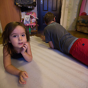 CAPTION: Yana lies down on her gymnastics mat next to her autistic brother Dmitry. LOCATION: St Petersburg, Russia. INDIVIDUAL(S) PHOTOGRAPHED: Yana Shpunt (left) and Dmitry Shpunt (right).