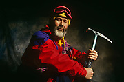 Portrait of the renowned British mountaineer,  adventurer, lecturer and writer Sir Chris Bonnington photographed at his home called Badger Hill, in Wigton, Cumbria, England. Bonnington is seen wearing a Gortex jacket against a backdrop holding an ice-axe used on a previous Himalayan mountain expedition. Bonnigton is best known for his 1975 expedition to conquer Mount Everest though he was formerly an army officer in the Royal Tank Regiment before making mountaineering and the writing of these sometimes tragic outcomes a career.