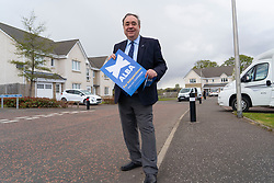 Falkirk, Scotland, UK. 30 April 2021. Leader of the pro Scottish nationalist Alba Party , Alex Salmond, campaigns with party supporters at the Falkirk Wheel ahead of Scottish elections on May 6th. Pic; Alex Salmond out canvassing residents in a housing estate in Falkirk.  Iain Masterton/Alamy Live News