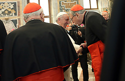 File photo - Pope Francis exchanges Christmas greetings with Australian Cardinal George Pell (R) at the Clementina Hall at the Vatican on December 22, 2014. Archbishop of Sydney he was created a cardinal in 2003. Cardinal George Pell has been found guilty of sexual offences in Australia, making him the highest-ranking Catholic figure to receive such a conviction. Pell abused two choir boys in the rooms of a Melbourne cathedral in 1996, a jury found. He had pleaded not guilty. The verdict was handed down in December, but it could not be reported until now due to legal reasons. Pell is due to face sentencing hearings from Wednesday. He has lodged an appeal against his conviction. Photo by Eric Vandeville/ABACAPRESS.COM
