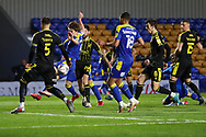 AFC Wimbledon midfielder Alex Woodyard (4) battles for possession with Bristol Rovers defender Max Ehmer (5) during the EFL Sky Bet League 1 match between AFC Wimbledon and Bristol Rovers at Plough Lane, London, United Kingdom on 5 December 2020.