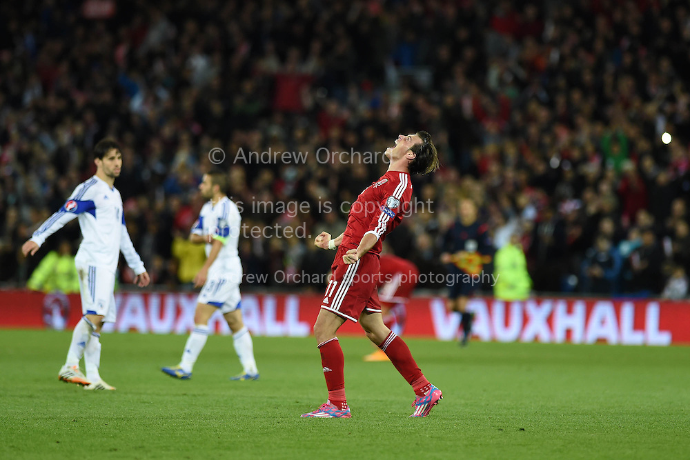 Gareth Bale of Wales shows his passion and delight as he celebrates his sides 2-1 win at the final whistle.  Euro 2016 qualifying group B match, Wales v Cyprus at the Cardiff city Stadium in Cardiff, South Wales on Monday 13th Oct 2014.<br /> pic by Andrew Orchard, Andrew Orchard sports photography.