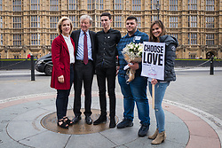 © Licensed to London News Pictures. 24/10/2017. London, UK. From left: Actress Juliet Stevenson, Lord Alfred Dubs, Ishmael and Kotaiba, child refugees from Syria, and Love Island star Camilla Thurlow stand for a photo outside Parliament at a demonstration for child refugees in Calais organised by Safe Passage and Help Refugees. Ismael and Kotaiba, both now 18, were transferred to the UK last year and are now studying. The demolition of the former 'Jungle' camp began one year ago, but many children still remain in Calais trying to reach Britain. Photo credit: Rob Pinney/LNP