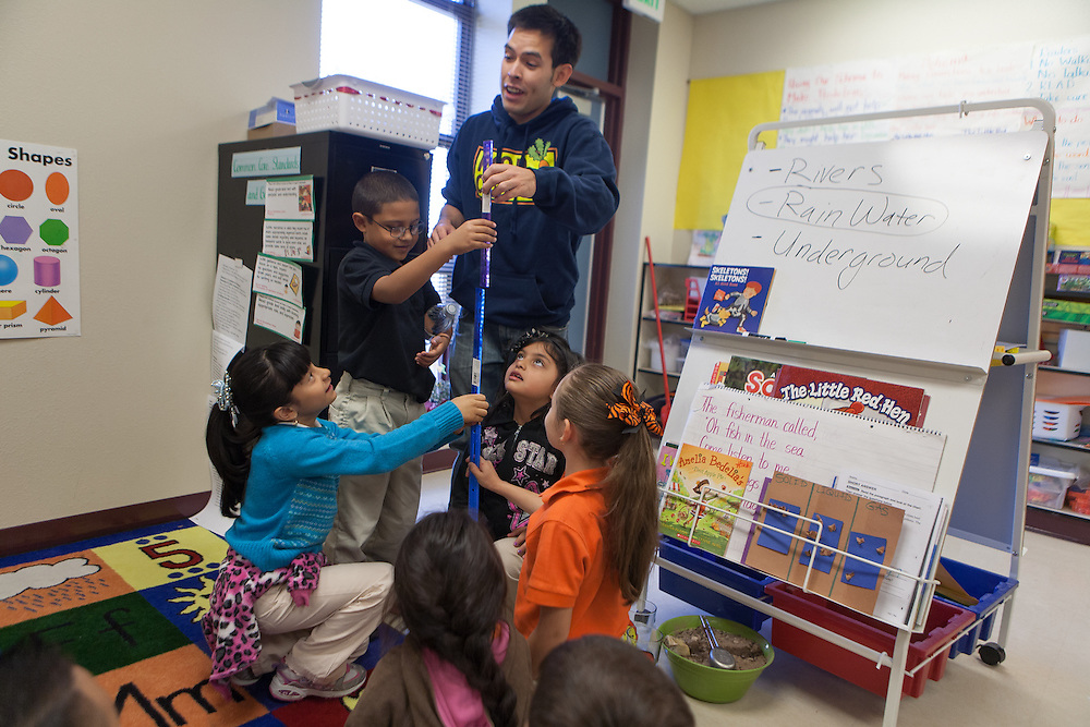 Food Corps Service Member Jacob Marquez works with a classroom of students at the Gadsden Elementary School garden. The farm to school program connects food system education with curriculum standards through hands on gardening and cooking.