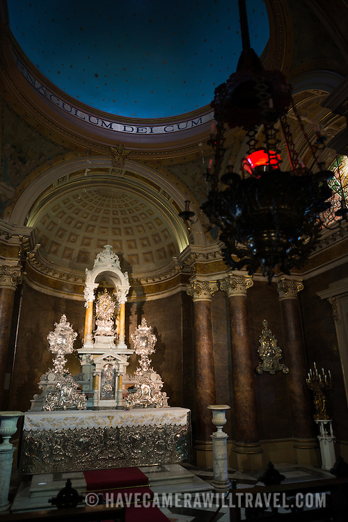 A small chapel with an ornate silver altar in the Metropolitan Cathedral of Santiago (Catedral Metropolitana de Santiago) in the heart of Santiago, Chile, facing Plaza de Armas. The original cathedral was constructed during the period 1748 to 1800 (with subsequent alterations) of a neoclassical design.