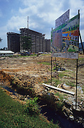BUILDING CONSTRUCTION, Malaysia. Building construction development,  destroying rainforest, Penang, West Malaysia. Much  rainforest is destroyed as new housing developments  encroach on otherwsie pristine  forest  land. The development destroys flora and  fauna, and wipes out ecosystems.