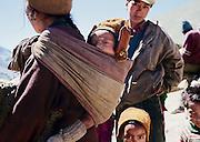Mother with child in sling. Ichar Village, Zanskar, Ladakh, India.