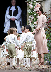 Catherine, Duchess of Cambridge arrives with the page boys and flower girls, including Prince George and Princess Charlotte, for the wedding of Pippa Middleton and James Matthews at St Mark's Church, Englefield Green on May 20, 2017.