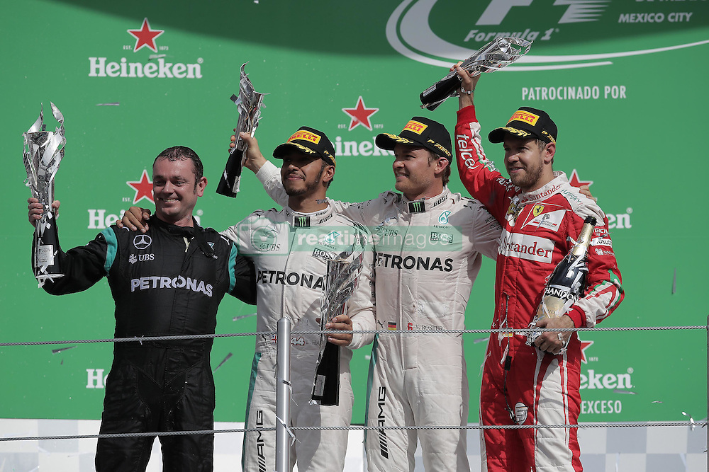 October 30, 2016 - Mexico - EUM20161030DEP26.JPG.CIUDAD DE MÉXICO Motoring/Automovilismo-F1 México.- Aspectos de la ceremonia de premiación del Gran Premio de México; el podio está integrado por Lewis Hamilton; de la escudería Mercedes (Primer Lugar); Nico Rosberg (Mercedes), en segunda posición; y Sebastian Vettel Ferrari), en tercero. El campeonato de la Fórmula 1 se celebra este domingo 30 de octubre de 2016 en el Autódromo Hermanos Rodríguez de la Ciudad de México. Foto: Agencia EL UNIVERSAL/Alejandro Acosta/RCC (Credit Image: © El Universal via ZUMA Wire)