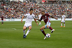 April 29, 2018 - Commerce City, Colorado - Colorado Rapids defender Edgar Castillo (2) tries to make a move past Orlando City SC midfielder Will Johnson (4) in the second half of action in the MLS soccer game between Orlando City SC and the Colorado Rapids at Dick's Sporting Goods Park in Commerce City, Colorado (Credit Image: © Carl Auer via ZUMA Wire)