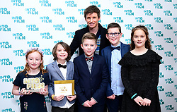 Eddie Redmayne presents children from the Hornsea Community Primary School with the award for Best Film: 11 Years and Under, during the fifth annual Into Film Awards, held at the Odeon Luxe in Leicester Square, London.