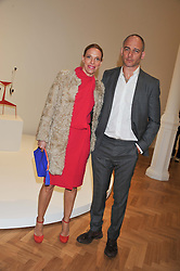 DINOS CHAPMAN and TIPHAINE DE LUSSY at a Private View of 'Calder - After The War' at Pace London, Burlington Gardens, London on 18th April 2013.
