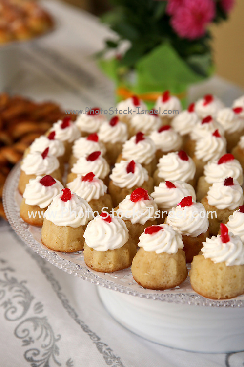 rum baba (or baba au rhum) a small yeast cake saturated in rum, and filled with whipped cream or pastry cream