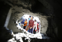September 20, 2016 - Kathmandu, Nepal - Nepalese people gather around the hole of a wall after a pressure cooker bomb exploded it at Akashdeep School in Jorpati, Kathmandu, Nepal on Tuesday, September 20, 2016. Improvised explosive devices were placed in 7 schools as 2 bombs exploded. No human casualties have been reported in the explosions. (Credit Image: © Skanda Gautam via ZUMA Wire)