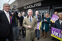 © Licensed to London News Pictures . 03/11/2015 . Oldham , UK . UKIP leader NIGEL FARAGE (c) with candidate JOHN BICKLEY (l) at the launch of their campaign for the seat of Oldham West and Royton , out and about in Royton Shopping Centre . The by-election has been triggered by the death of MP Michael Meacher . Photo credit : Joel Goodman/LNP