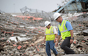 Workers inspect the scene after a large scale demolition.