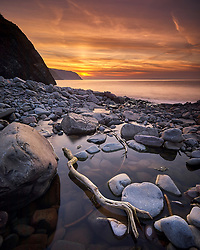 The sun sets in a blaze of colour off Hartland Post in Devon