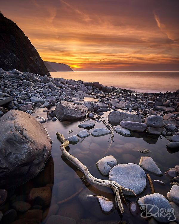 The sun sets in a blaze of colour off Hartland Post in Devon