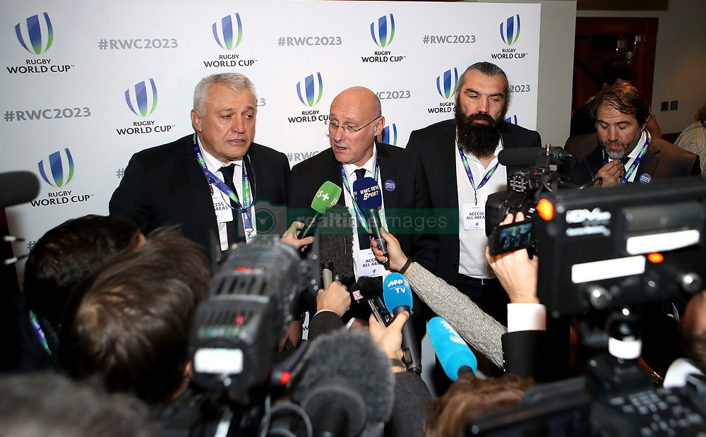 Sebastien Chabal (second right), France 2023 bid president Claude Atcher (left) and France Rugby Federation President Bernard Laporte (centre) speak to the media after France was named as the 2023 Rugby World Cup host union at an announcement at The Royal Garden Hotel, Kensington.
