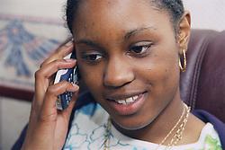 Teenage girl using a mobile phone,