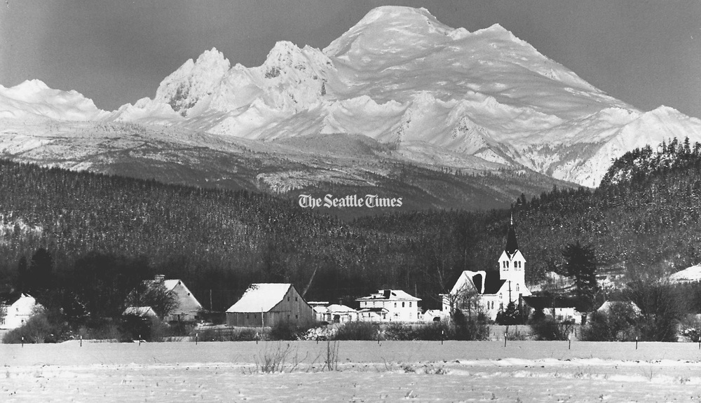 Seattle Times photographer Josef Scaylea returned again and again to the Skagit Valley. Mount Baker looms behind the little village of Conway. (Josef Scaylea / The Seattle Times, 1983)