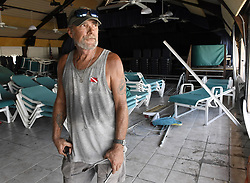 """Cudjoe Key resident Bob Skinner, 84, walks away with some cold water from Mark Lum, 57, who rode out powerful Hurricane Irma with his dog, Cruzan, and another friend in the Venture Out Condominium's bathhouse. """"We felt like the world was coming to an end,"""" said Lum on Tuesday, September 12, 2017. Photo by Taimy Alvarez/Sun Sentinel/TNS/ABACAPRESS.COM"""
