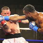 """Jonathan """"Popeye"""" Perez of Barranquilla, Colombia (R) punches Raul Chirino of Miami, Florida during a Nelsons Promotions boxing match at the Boca Raton Resort  and Club on Friday, May 26, 2017 in Boca Raton, Florida.  (Alex Menendez via AP)"""