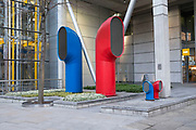 Red and blue air ducts shaped like funnels. Strange architectural elements on the empty City of London streets. UK.
