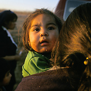 Undocumented immigrant women and their children living in the hills of San Diego, CA are given aid by a charity.