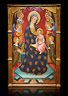 Gothic painted Panel Virgin of the Angels by Pere Serra. Tempera and gold leaf on wood. Circa 1385. 195.8 x 131 x 11 cm. Comes from Tortosa cathedral (Baix Ebre). <br /> This splendid central panel and the two sections of the predella with saints (which must once have flanked a tabernacle) are all that remains of an altarpiece. It was dedicated to the Virgin Mary and was painted for one of the chapels in the ambulatory of Tortosa cathedral, probably towards the 1380s. The compartment with the Virgin and Child surrounded by angels playing music is a very graceful and refined version of an iconographic type that was extremely popular at the time. Pere Serra, author of the altarpiece, came from a family of painters who grew to head the Catalan painting of the second half of the fourteenth century. National Museum of Catalan Art, Barcelona, Spain, inv no: 003950-000 .<br /> <br /> If you prefer you can also buy from our ALAMY PHOTO LIBRARY  Collection visit : https://www.alamy.com/portfolio/paul-williams-funkystock/gothic-art-antiquities.html  Type -     MANAC    - into the LOWER SEARCH WITHIN GALLERY box. Refine search by adding background colour, place, museum etc<br /> <br /> Visit our MEDIEVAL GOTHIC ART PHOTO COLLECTIONS for more   photos  to download or buy as prints https://funkystock.photoshelter.com/gallery-collection/Medieval-Gothic-Art-Antiquities-Historic-Sites-Pictures-Images-of/C0000gZ8POl_DCqE