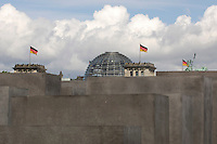 "09 MAY 2005, BERLIN/GERMANY:<br /> Die Reichstagskuppel, Flaggen und die Quadriga, hinter dem Denkmal fuer die ermordeten Juden Europas, einen Tag vor der Eröffnung, bei bewölktem Himmel<br /> The Reichstag and the Quadriga behind the new memorial to the millions of Jews killed by the Nazis the ""Memorial to the murdered Jews of Europe"", on day before the official opening in central Berlin <br /> IMAGE: 20050509-03-005<br /> KEYWORDS: Denkmal für die ermordeten Juden Europas; Holocaust Mahnmal"