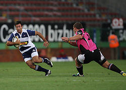 Paul Bosch of the DHL Stormers sets off on a run with Rossouw Kruger of Boland on defense during the final warm-up match before the start of the Super Rugby season between the DHL Stormers and the Boland Cavaliers held at DHL Newlands Stadium in Cape Town, South Africa on 12 February 2011. Photo by Jacques Rossouw/SPORTZPICS