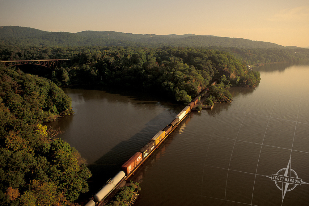 Freight Train in River Valley.